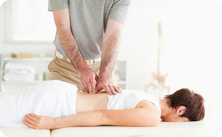 the treatment of lordosis of the spine using massage and special exercises