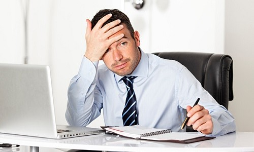 stress at work - cause headaches in the crown of the head