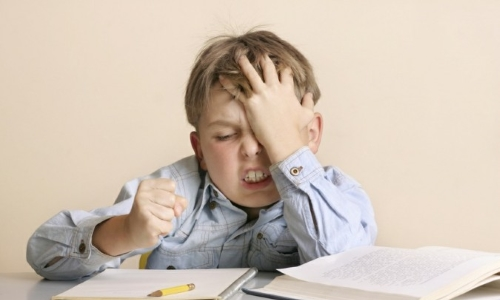 Stress and mental overload is a common cause of headaches in children