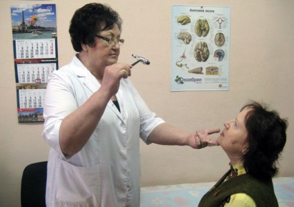 On examination by a neurologist, the patient with headache