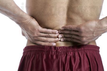 back pain is a symptom of spondylolisthesis